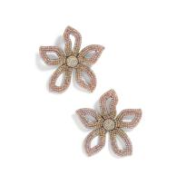 https://shop.nordstrom.com/s/baublebar-primina-flower-drop-earrings/5122253?origin=category-personalizedsort&breadcrumb=Home%2FWomen%2FAccessories%2FJewelry%2FEarrings%2FStatement%20Earrings&color=pink